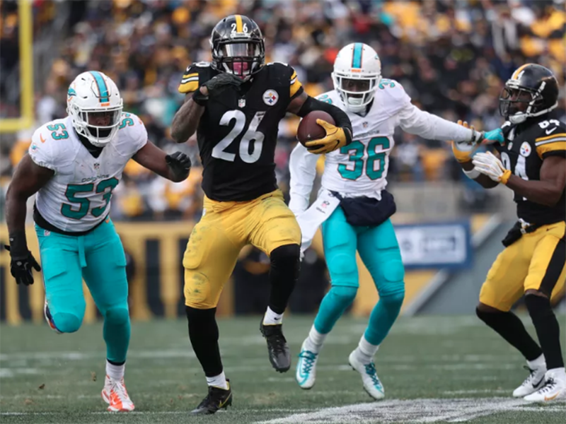 Behind Bell's record performance, Steelers roll over Dolphins